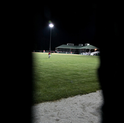 Bubby Williams game winning home run as seen through a knot hole in the left field fence
